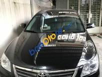 Gia đình cần bán gấp xe Toyota Camry 2.4G đời 2009 màu đen