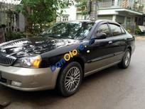 Cần bán Daewoo Magnus AT sản xuất 2005, màu đen số tự động, giá tốt