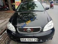Bán xe cũ Toyota Corolla đời 2003, màu đen số sàn, giá chỉ 230 triệu