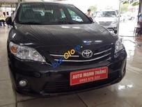 Chính chủ bán Toyota Corolla altis 1.8 AT năm 2014, màu đen, 710 triệu