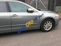 Cần bán xe Toyota Camry sản xuất 2010, màu bạc số tự động