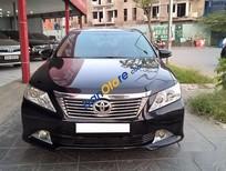 Cần bán xe Toyota Camry 2.0E sản xuất 2013, màu đen chính chủ, 815tr