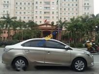 Bán Toyota Vios 1.5E đời 2015, màu vàng