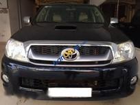 Cần bán xe cũ Toyota Hilux 3.0 năm 2011, màu đen, nhập khẩu