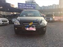 Cần bán xe cũ Kia Carens SX 2010, màu đen số tự động, 425tr