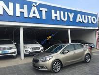 Cần bán xe cũ Kia K3 sản xuất 2014, màu vàng cát