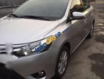 Bán Toyota Vios E năm 2015, màu bạc số sàn