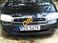 Cần bán xe Kia Spectra năm 2004, màu đen xe gia đình giá cạnh tranh