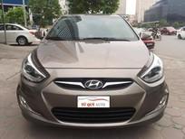 Bán ô tô Hyundai Accent Blue   1.4AT đời 2014, màu nâu, nhập khẩu nguyên chiếc, số tự động giá cạnh tranh