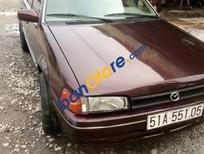 Cần bán gấp Mazda 323 sản xuất 1988, màu nâu