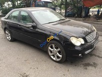 Cần bán Mercedes 1.8 AT đời 2005, màu đen xe 1 chủ từ đầu
