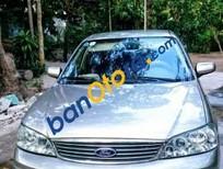 Cần bán xe ô tô Ford Laser Ghia 1.8 sx 2003, màu vàng cát