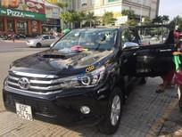 Cần bán Toyota Hilux G 4x4AT sản xuất năm 2016, màu đen, nhập khẩu