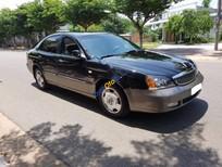 Cần bán lại xe Daewoo Magnus năm 2004, màu đen