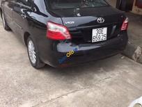 Cần bán Toyota Vios E đời 2010, màu đen, đi được 100.000 Km