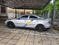 Cần bán xe cũ Mazda 6 Sport đời 2003, màu bạc, nhà đang dùng, máy móc còn tốt