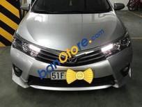 Chính chủ bán xe Toyota Corolla Altis AT năm 2015, màu bạc