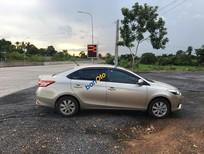 Cần bán Toyota Vios sản xuất năm 2015, màu vàng cát