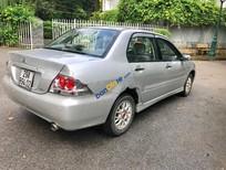 Cần bán xe Mitsubishi Lancer GLX đời 2005, màu bạc chính chủ, giá chỉ 259 triệu