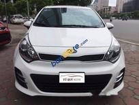 Cần bán xe Kia Rio 1.4AT đời 2015, màu trắng, xe đẹp xuất sắc, sơn zin 99%, lăn bánh 18.000 Km