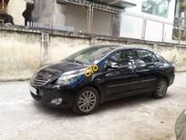 Bán xe Toyota Vios E đời 2013, màu đen số sàn