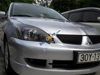 Cần bán xe Mitsubishi Lancer GLX đời 2010, màu bạc, nhập khẩu nguyên chiếc còn mới