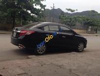 Bán xe cũ Toyota Vios 2015, màu đen số sàn, giá tốt