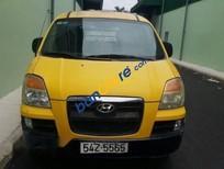Bán xe Hyundai Starex đời 2009, màu vàng