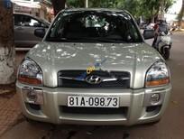 Cần bán lại xe Hyundai Tucson 2.0AT đời 2010, màu vàng, nhập khẩu chính hãng