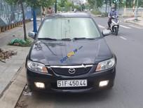 Cần bán gấp Mazda 323 Classic sản xuất năm 2002, màu đen