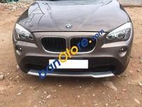 Cần bán BMW X1 AT sản xuất năm 2010, màu nâu, nhập khẩu, 700 triệu