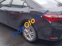 Chính chủ bán xe Toyota Corolla altis 1.8G 2015, màu đen, số tự động