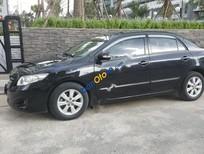 Chính chủ bán xe Toyota Corolla altis 1.8MT đời 2010, màu đen, giá cạnh tranh