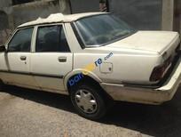 Bán ô tô Mazda 323 đời 1980, màu trắng cho các anh chị tập lái