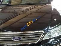 Bán xe cũ Ford Mondeo đời 2004, màu đen, xe gia đình sử dụng, xe còn mới, hoạt động tốt