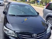 Bán xe Toyota Corolla altis 1.8MT đời 2010, màu đen chính chủ