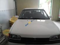Cần bán Mazda 323 năm sản xuất 1995, màu trắng, xe nhập, giá chỉ 90 triệu