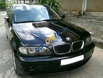 Bán xe BMW 318i sản xuất 2002, màu đen, nhập khẩu nguyên chiếc số sàn, giá 199tr