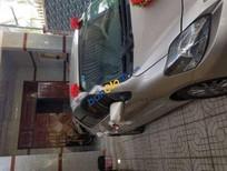 Bán Toyota Vios E đời 2014, màu vàng