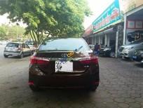 Cần bán xe Toyota Corolla Altis 1.8 AT đời 2014, màu nâu đẹp như mới giá cạnh tranh