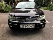 Bán Ford Laser 1.8AT đời 2005, màu đen, xe còn tốt và mới