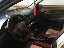Bán Mercedes C200 đời 2003, màu đen số sàn