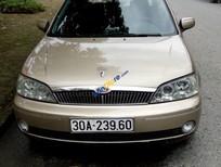 Bán Ford Laser 1.8 sản xuất năm 2002, màu vàng, giá 155tr