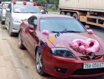 Cần bán Hyundai Tuscani 2.0MT năm 2005, màu đỏ, xe nhập xe gia đình giá cạnh tranh
