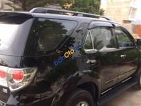Bán xe Toyota Fortuner G đời 2013, màu đen số sàn