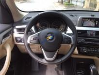 Cần bán BMW X1 Sdrive1.8i đời 2016, màu trắng, xe nhập số tự động