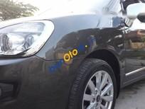 Cần bán lại xe Kia Carens EX 2.0 đời 2011, màu đen còn mới, 325tr