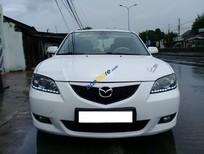 Cần bán lại xe Mazda 3 năm sản xuất 2004, màu trắng xe gia đình, giá chỉ 270 triệu