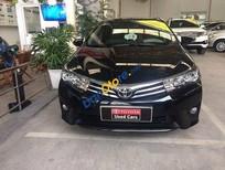 Bán Toyota Corolla altis 1.8G đời 2015, màu đen, 690tr