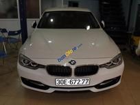 Bán BMW 320i đời 2014, màu trắng, nhập khẩu nguyên chiếc chính chủ.